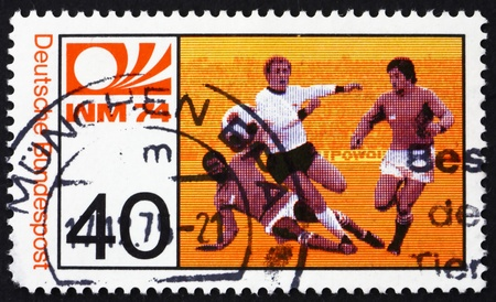 GERMANY - CIRCA 1974: a stamp printed in the Germany shows Three Soccer Players, World Cup Soccer Championship, Munich, circa 1974