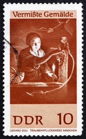 ddr: GDR - CIRCA 1967: a stamp printed in GDR shows Girl Gathering Grapes, Painting by Gerard Dou, circa 1967