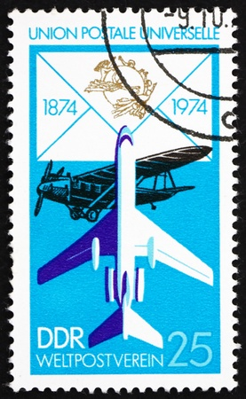 upu: GDR - CIRCA 1974: a stamp printed in GDR shows Biplane and Jet, Centenary of the UPU, Union Postale Universelle, circa 1974
