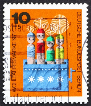 GERMANY - CIRCA 1971: a stamp printed in the Germany, Berlin shows Movable Dolls in Box, Wooden Toy, circa 1971