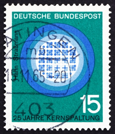 fission: GERMANY - CIRCA 1964: a stamp printed in the Germany shows Nuclear Fission, 25th Anniversary, Hahn and Strassmann, circa 1964