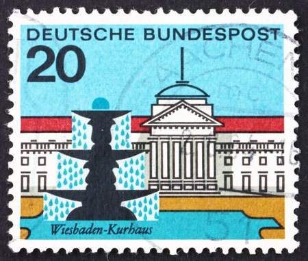 GERMANY - CIRCA 1964: a stamp printed in the Germany shows Fountain and Building, Wiesbaden, circa 1964 Stock Photo - 15699238