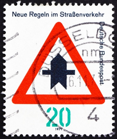 to proceed: GERMANY - CIRCA 1971: a stamp printed in the Germany shows Proceed with Caution, new traffic rules, circa 1971