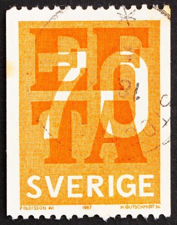 abolished: SWEDEN - CIRCA 1967: a stamp printed in the Sweden shows EFTA Emblem, European Free Trade Association, Abolished Tariffs among EFTA members, circa 1967 Editorial