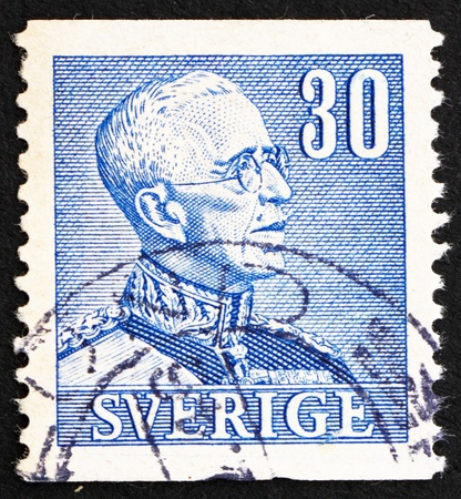 SWEDEN - CIRCA 1940: a stamp printed in the Sweden shows King Gustaf V, King of Sweden, circa 1940 Stock Photo - 15740634
