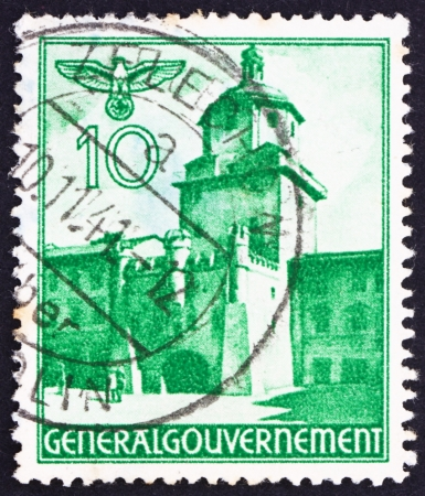 POLAND - CIRCA 1940: a stamp printed in the Poland under German Occupation shows Cracow Gate, Lublin, circa 1940 Stock Photo - 15837364