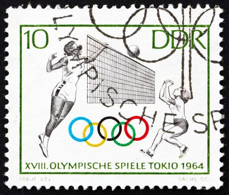 summer olympics: GDR - CIRCA 1964: a stamp printed in GDR shows Volleyball, 18th Olympic Games, Tokyo 64, circa 1964