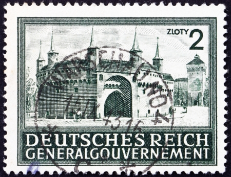 POLAND - CIRCA 1943: a stamp printed in the Poland under German Occupation shows Rondel and Florian�s Gate, Cracow, circa 1943 Stock Photo - 15838111
