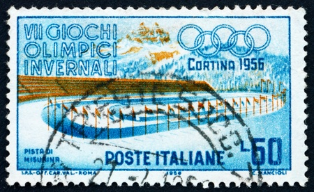 lake misurina: ITALY - CIRCA 1956: a stamp printed in the Italy shows Ice Racing, Lake Misurina, 7th Winter Olympic Games at Cortina d�Ampezzo, circa 1956