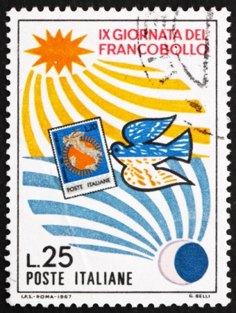 ITALY - CIRCA 1967: a stamp printed in the Italy shows Day and Night and Pigeon Carrying Map of Italy, Stamp Day, circa 1967