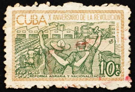perforated stamp: CUBA - CIRCA 1963: a stamp printed in the Cuba shows Agricultural Reform and Nationalization of Industry, 10th Anniversary of Cuban Revolution, circa 1963