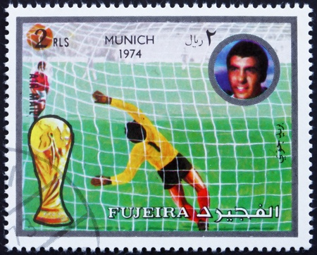 FUJEIRA - CIRCA 1972: a stamp printed in the Fujeira shows Football Scene, Football World Championship 1974, Germany, circa 1972 Editorial