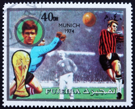 fujeira: FUJEIRA - CIRCA 1972: a stamp printed in the Fujeira shows Football Scene, Football World Championship 1974, Germany, circa 1972 Editorial