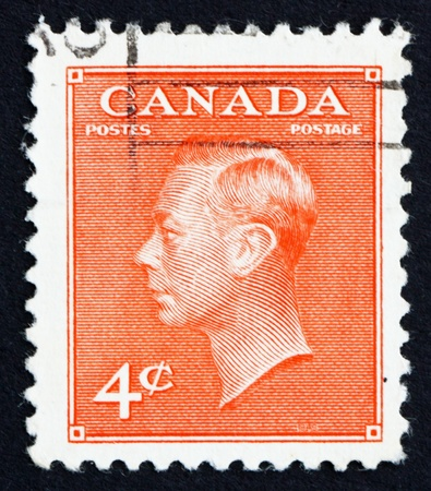 CANADA - CIRCA 1949 a stamp printed in the Canada shows King George VI, King of England, circa 1949 Stock Photo - 15927339