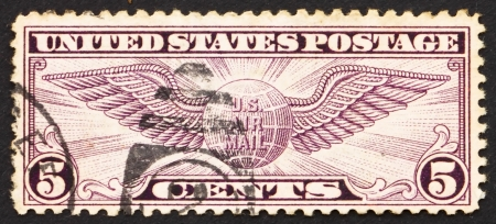 UNITED STATES OF AMERICA - CIRCA 1930: a stamp printed in the USA shows Winged Globe, circa 1930