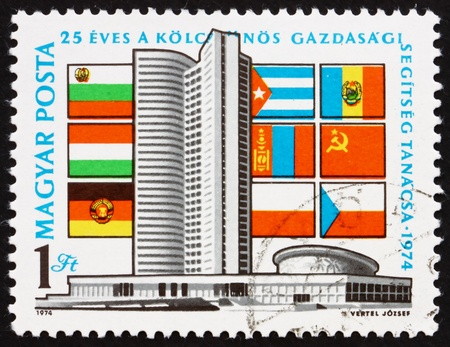HUNGARY - CIRCA 1974: a stamp printed in the Hungary shows Comecon Building, Moscow and Flags, 25th Anniversary of the Council of Mutual Economic Assistance, circa 1974 Stock Photo - 15942866