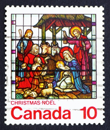 CANADA - CIRCA 1976: a stamp printed in the Canada shows Nativity, Stained-glass Window, St. Jude, London, Ontario, circa 1976