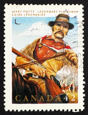 interpreter: CANADA - CIRCA 1992: a stamp printed in the Canada shows Jerry Potts, Guide, Interpreter, Legendary Hero, circa 1992