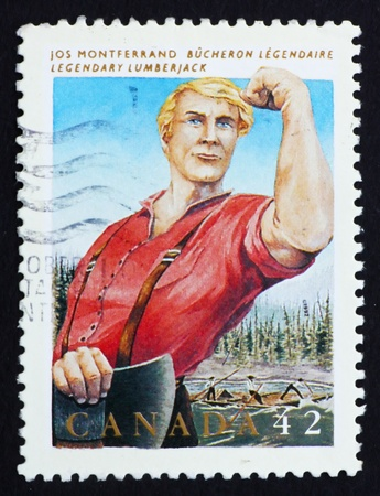 CANADA - CIRCA 1992: a stamp printed in the Canada shows Jos Monferrand, Lumberjack, Legendary Hero, circa 1992 Stock Photo - 15942848
