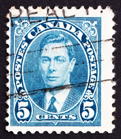 vi: CANADA - CIRCA 1937 a stamp printed in the Canada shows King George VI, King of England, circa 1937