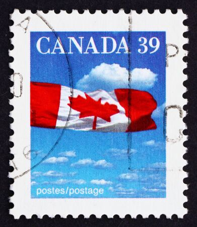 CANADA - CIRCA 1987: a stamp printed in the Canada shows Canadian Flag and Clouds, circa 1987 Stock Photo - 16093776