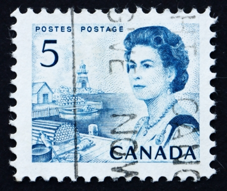 CANADA - CIRCA 1967: a stamp printed in the Canada shows Lobster Traps and Boat, Atlantic Provinces, Queen Elizabeth II, circa 1967