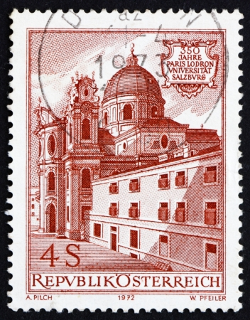 AUSTRIA - CIRCA 1972: a stamp printed in the Austria shows Church and Old University, 350th Anniversary of Paris Lodron University, Salzburg, circa 1972 Stock Photo - 16093805