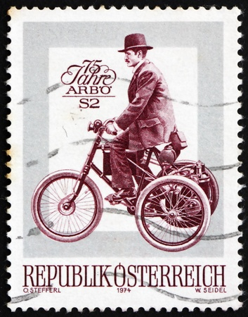 antique tricycle: AUSTRIA - CIRCA 1974: a stamp printed in the Austria shows De Dion Bouton Motor Tricycle, 75th Anniversary of Austrian Automobile Association, circa 1974 Editorial