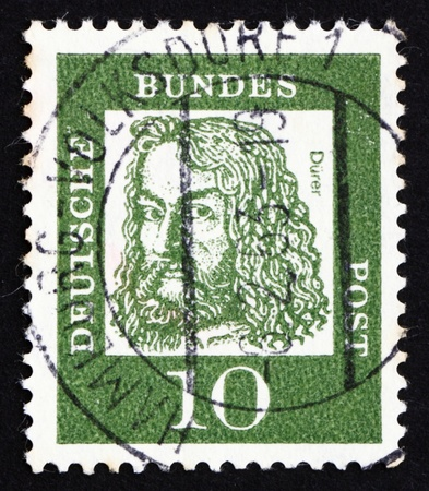printmaker: GERMANY - CIRCA 1961: a stamp printed in the Germany shows Albrecht Durer, painter and engraver, circa 1961
