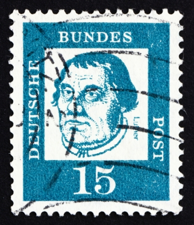 initiated: GERMANY - CIRCA 1963: a stamp printed in the Germany shows Martin Luther, German Priest, who initiated the Protestant reformation, circa 1963