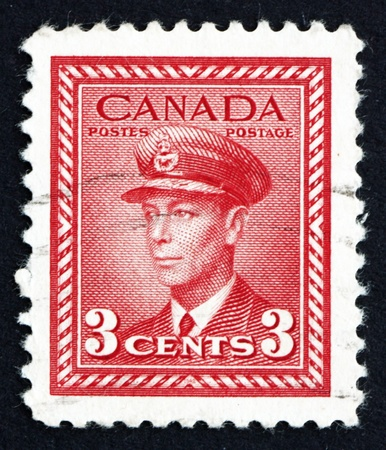 vi: CANADA - CIRCA 1942 a stamp printed in the Canada shows King George VI, King of England, circa 1942