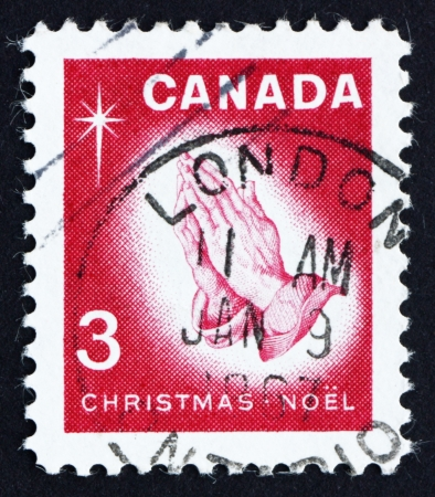 durer: CANADA - CIRCA 1966: a stamp printed in the Canada shows Praying Hands, by Albrecht Durer, Christmas, circa 1966 Editorial