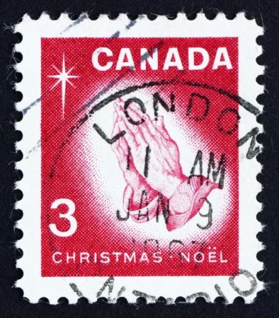 durer: CANADA - CIRCA 1966: un timbro stampato in Canada mostra Praying Hands, di Albrecht Durer, Natale, circa 1966 Editoriali