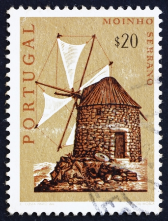 PORTUGAL - CIRCA 1971: a stamp printed in the Portugal shows Mountain Windmill, Bussaco Hills, circa 1971 Stock Photo - 16224725