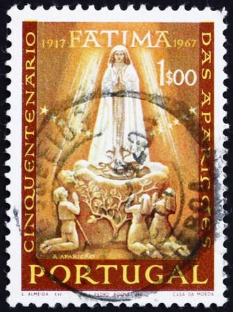 apparition: PORTUGAL - CIRCA 1985: a stamp printed in the Portugal shows Apparition of Our Lady of Fatima, 50th Anniversary, circa 1985