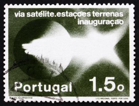 establishment: PORTUGAL - CIRCA 1974: a stamp printed in the Portugal shows Pattern of Light Emission, Establishment of Satellite Communications Network, circa 1974