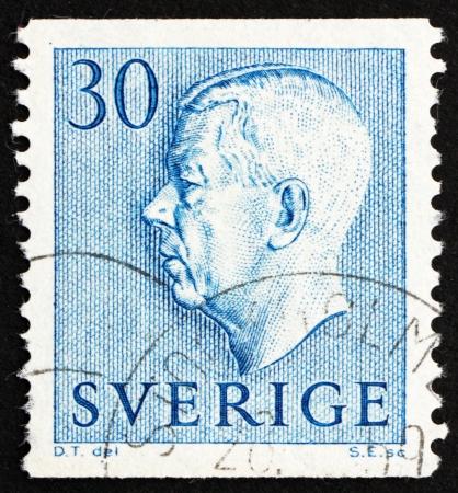 gustaf: SWEDEN - CIRCA 1951: a stamp printed in the Sweden shows King Gustaf VI Adolf, circa 1951