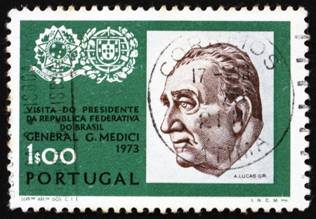 PORTUGAL - CIRCA 1973: a stamp printed in the Portugal shows General Emilio Garrastazu Medici, President of Brazil, Arms of Brazil and Portugal, circa 1973 Stock Photo - 16224768