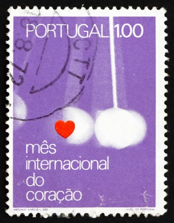 PORTUGAL - CIRCA 1972: a stamp printed in the Portugal shows Heart and Pendulum, Your Heart is Your Health, World Health Day, circa 1972 Stock Photo - 16224764