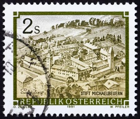 AUSTRIA - CIRCA 1991: a stamp printed in the Austria shows Benedictine Monastery, Michaelbeuern, Salzburg, circa 1991 Stock Photo - 16224784