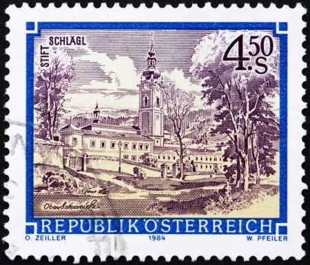 AUSTRIA - CIRCA 1984: a stamp printed in the Austria shows Schlagl Monastery, Upper Austria, circa 1984 Stock Photo - 16224783