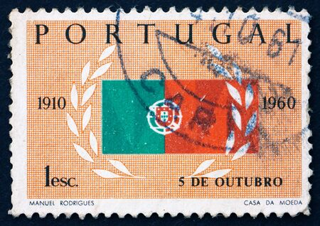 PORTUGAL - CIRCA 1960: a stamp printed in the Portugal shows Flag and Laurel, 50th Anniversary of the Republic, circa 1960 Stock Photo - 16284626