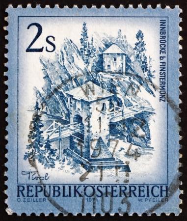 alt: AUSTRIA - CIRCA 1974: a stamp printed in the Austria shows Inn Bridge, Alt Finstermunz, Tirol, circa 1974