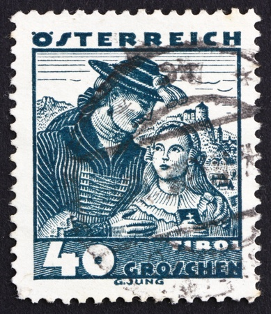 AUSTRIA - CIRCA 1929: a stamp printed in the Austria shows Couple from Tyrol, Regional Costume, circa 1929 Stock Photo - 16286336
