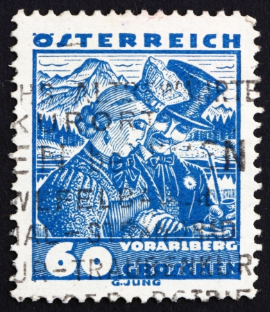AUSTRIA - CIRCA 1929: a stamp printed in the Austria shows Bridal Couple from Vorarlberg, Regional Costume, circa 1929 Stock Photo - 16286340