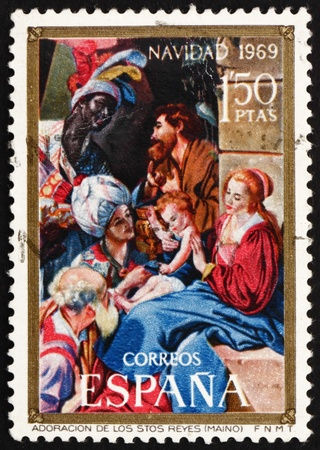adoration: SPAIN - CIRCA 1969: a stamp printed in the Spain shows Adoration of the Magi, by Juan Bautista Mayno, Painting, Christmas, circa 1969 Editorial