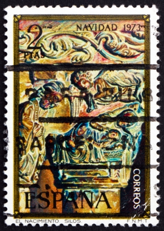 SPAIN - CIRCA 1973: a stamp printed in the Spain shows Nativity, Column Capital from Silos Church, Christmas, circa 1973 Stock Photo - 16337339