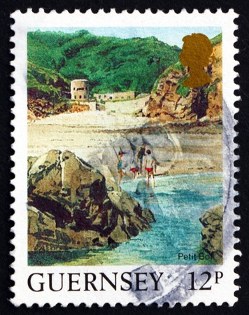 GUERNSEY - CIRCA 1988: a stamp printed in the Guernsey shows Petit Bot Beach, Landscape, circa 1988 Stock Photo - 16348232