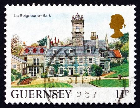 sark: GUERNSEY - CIRCA 1985: a stamp printed in the Guernsey shows La Seigneurie, Sark, circa 1985 Editorial