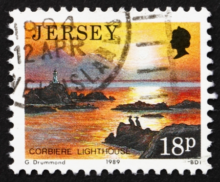 JERSEY - CIRCA 1989: a stamp printed in the Jersey shows Corbiere Lighthouse, Scenic View, circa 1989 Stock Photo - 16348233